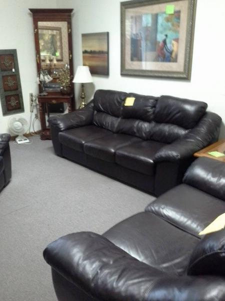 [Image: These black leather sofas are ideal for a person who loves a great deal on furniture! ]
